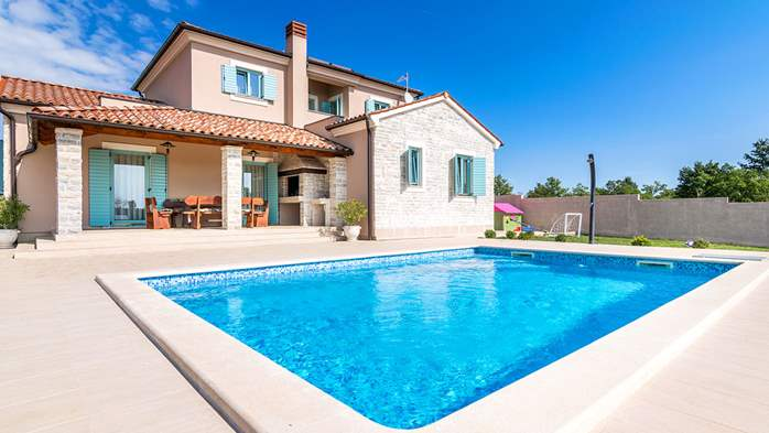 New, modernly decorated villa with a pool and stone details, 6