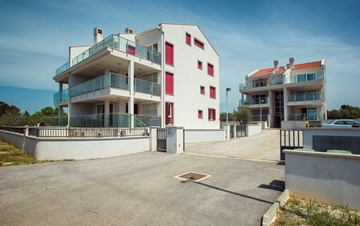 Modern building in Peroj offers accommodation in nice apartments
