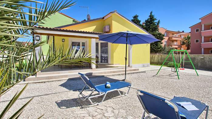 House near the sea in Medulin offers a private yard with BBQ, 1