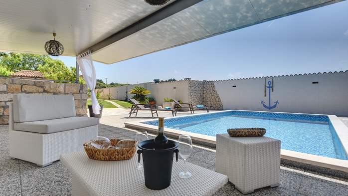 Villa with pool and outdoor kitchen surrounded by greenery, 11