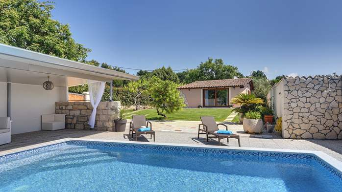 Villa with pool and outdoor kitchen surrounded by greenery, 1