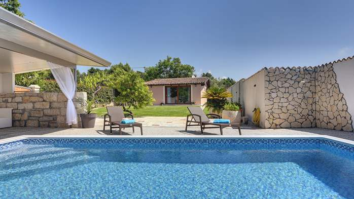 Villa with pool and outdoor kitchen surrounded by greenery, 6