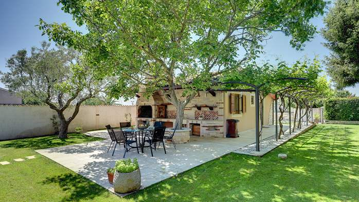 Villa with pool and outdoor kitchen surrounded by greenery, 7