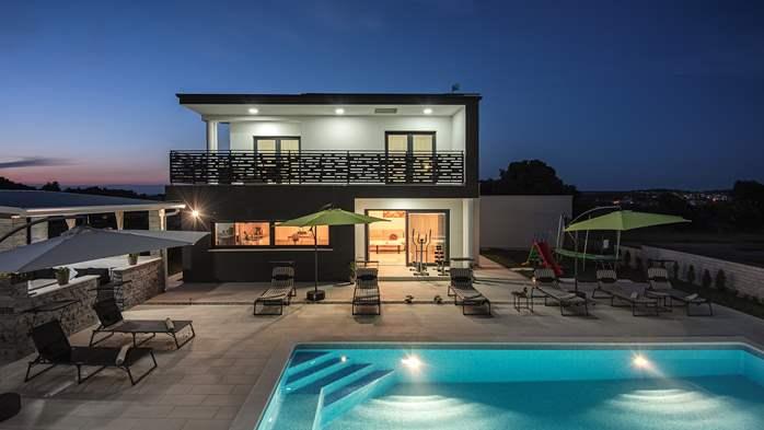 Modern villa in Štinjan offers a saltwater pool, Wi-Fi, BBQ, 1