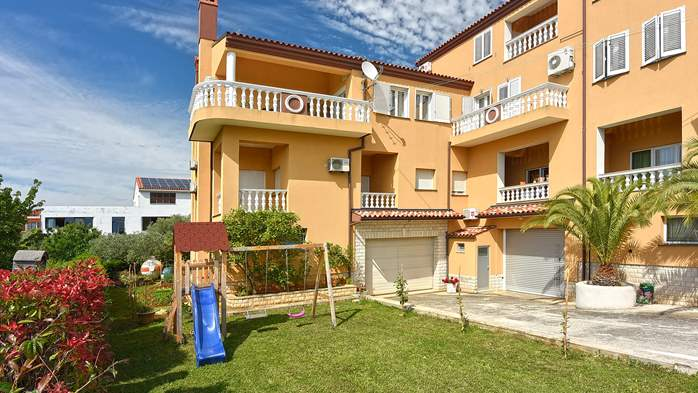Apartments in Galizana with landscaped garden and children's play, 17