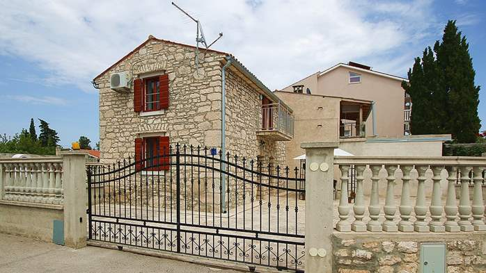 Stone house in Premantura with fenced courtyard with barbecue, 2
