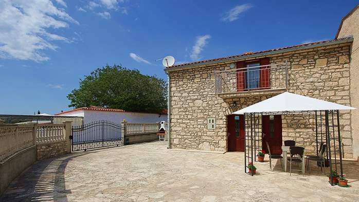 Stone house in Premantura with fenced courtyard with barbecue, 3