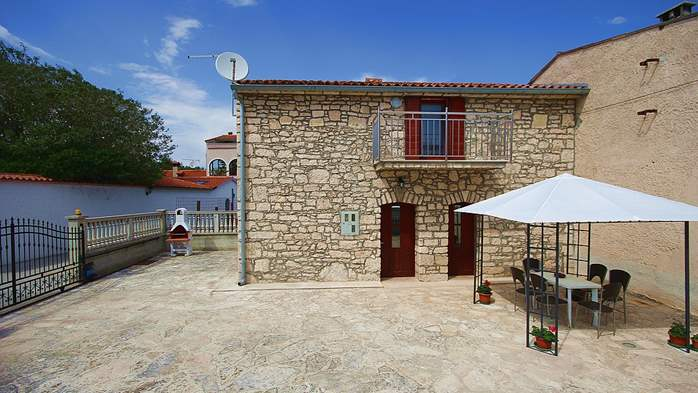 Stone house in Premantura with fenced courtyard with barbecue, 4