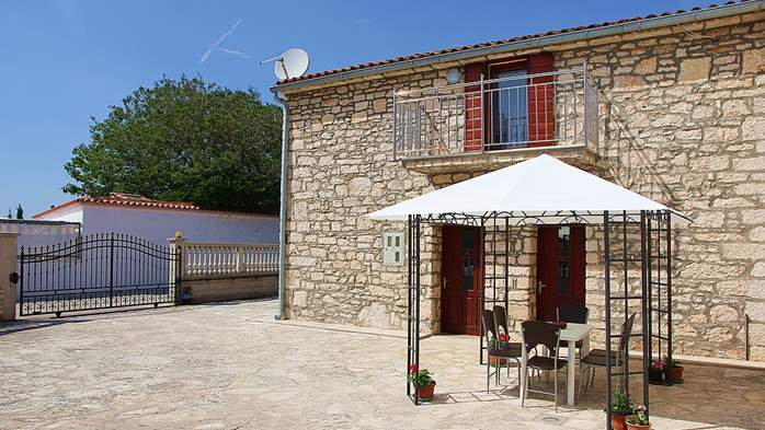 Stone house in Premantura with fenced courtyard with barbecue, 7