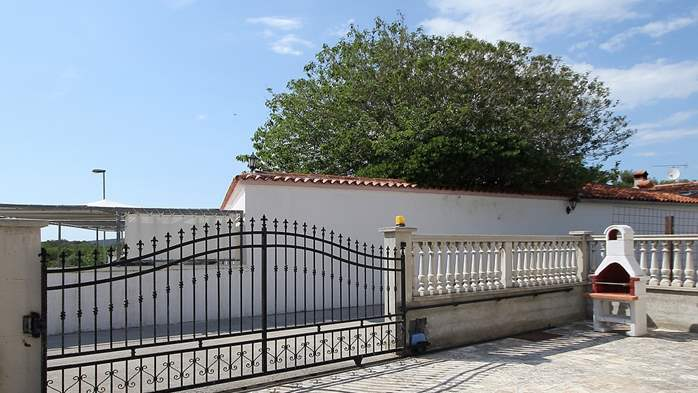 Stone house in Premantura with fenced courtyard with barbecue, 12