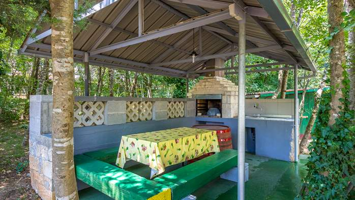 Holiday house with terrace, BBQ and playground for children, 5