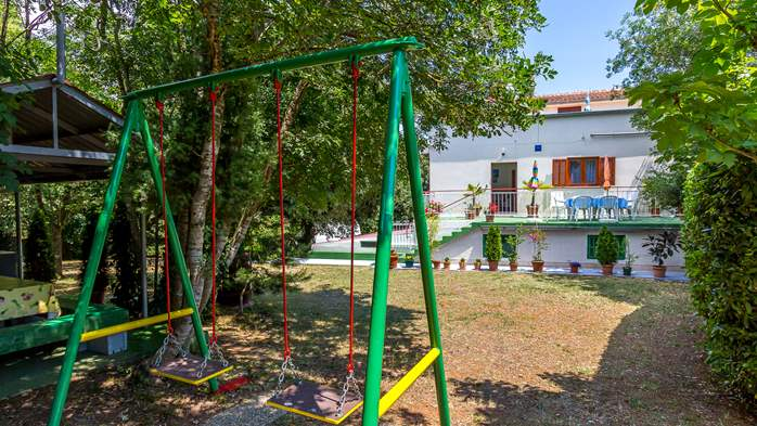 Holiday house with terrace, BBQ and playground for children, 4