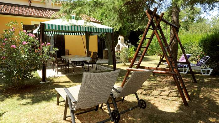 Holiday home in Medulin with private garden and playground, 1