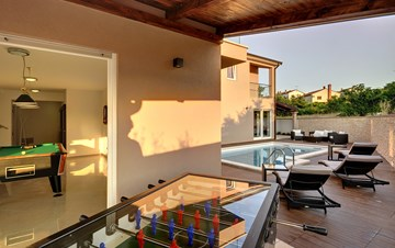 Modern villa with a private pool and summer kitchen with TV