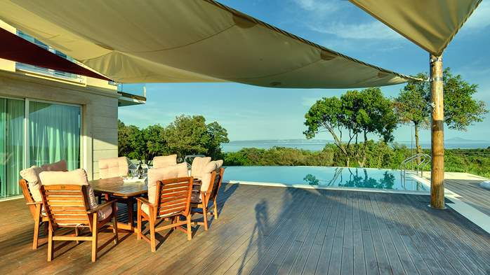 Villa with infinity pool, glass sauna,terrace and unique sea view, 18