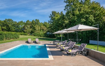 Holiday home with pool with whirlpool and playground for kids