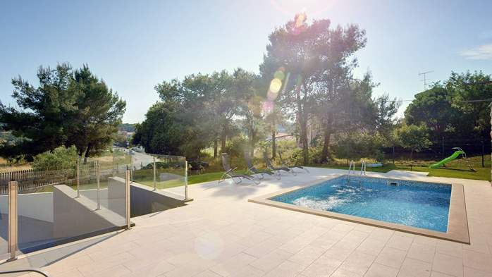 Modern villa, private pool, huge sunbathing terace, playground, 4