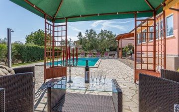 Villa with private pool and terrace, surrounded by lush greenery