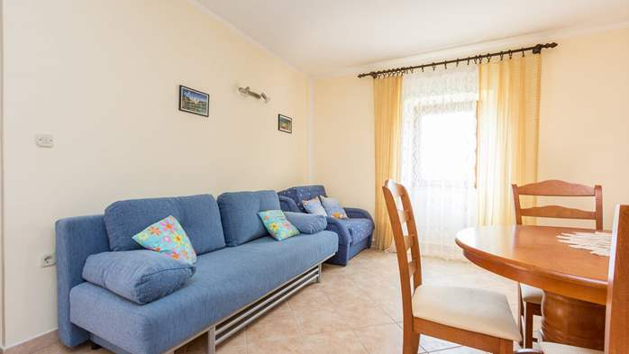 Homey air conditioned apartment, with nice covered balcony, 1