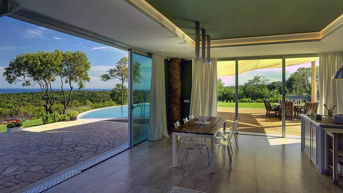 Villa with infinity pool, glass sauna,terrace and unique sea view, 29