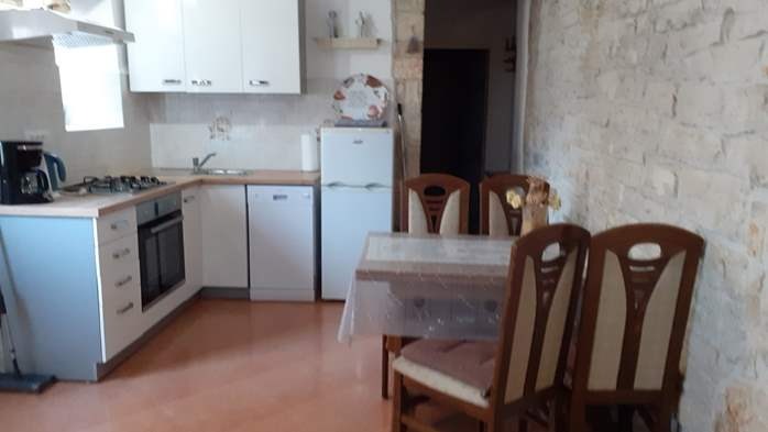 Apartment for 3 persons with stone details, pool, playground, 2