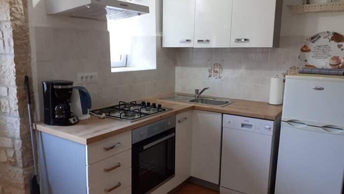 Apartment for 3 persons with stone details, pool, playground, 1