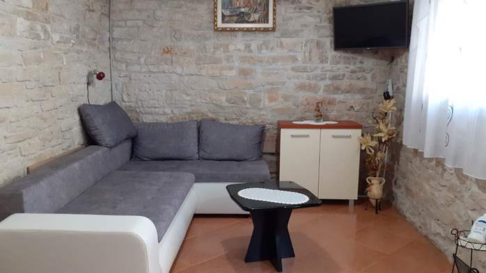 Apartment for 3 persons with stone details, pool, playground, 3