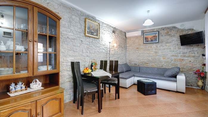 Apartment for 4 persons with stone details, pool, playground, 2