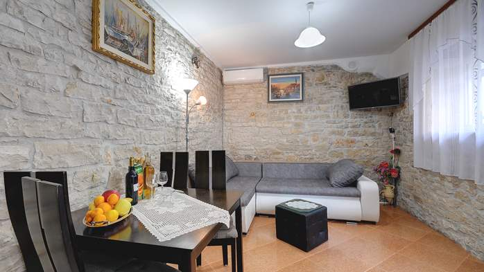 Apartment for 4 persons with stone details, pool, playground, 1
