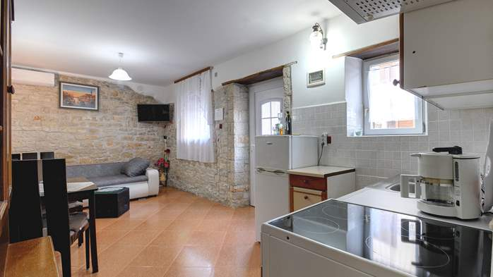 Apartment for 4 persons with stone details, pool, playground, 4