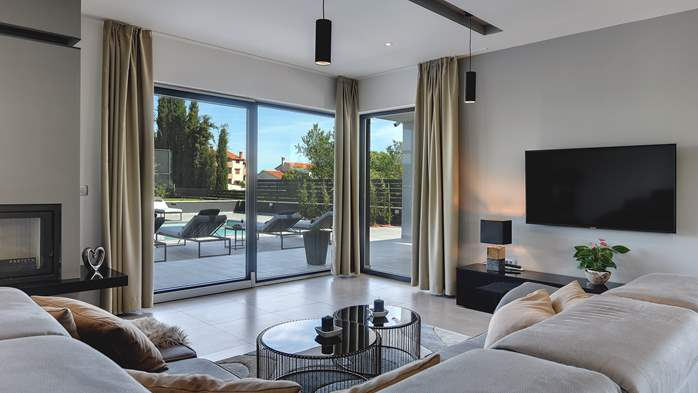 Modern villa in Pula, for 10 persons, offers a pool and sauna, 15