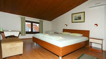 Arranged room with a bathroom in the attic with a sea view, 1