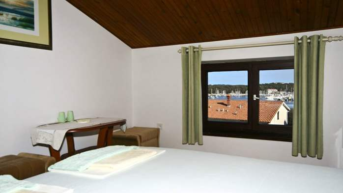 Arranged room with a bathroom in the attic with a sea view, 2