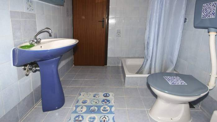 Arranged room with a bathroom in the attic with a sea view, 6