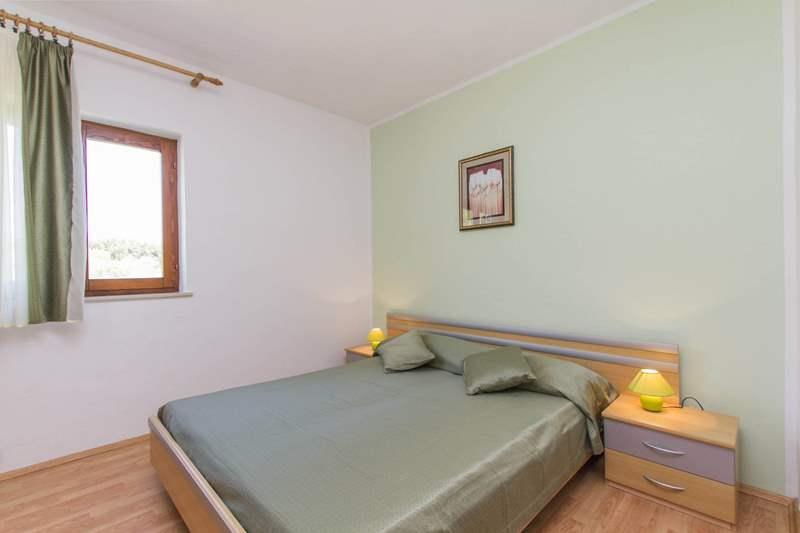 Casa in zona tranquilla offre alloggio per vacanza rilassante for Casa con 5 camere da letto e 2 piani
